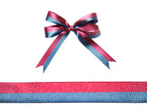 Multicolor blue-red fabric ribbon and bow isolated on a white background Royalty Free Stock Image