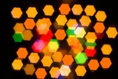 Multicolor bokeh hexagon shape from night lights Stock Image
