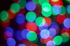 Multicolor bokeh of LED light. Multicolor bokeh of LED light on dark background Stock Photos