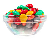 Multicolor bonbon sweets in glass bowl, isolated Royalty Free Stock Photos