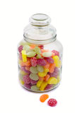 Multicolor bonbons in glass pot. On the white background Stock Photos