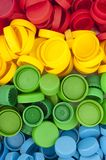 Multicolor bottle cups for recycling. Royalty Free Stock Image