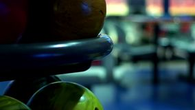 Multicolor bowling balls in bowling club slow motion. Close up bowling balls for bowling game stock video