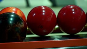 Multicolor bowling balls for bowling game. Close up stock video footage
