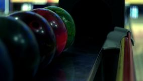 Multicolor bowling balls on bowling machine. Close up. Bowling balls for play bowling stock video footage