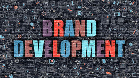 Multicolor Brand Development on Dark Brickwall. Doodle Style. Stock Photo