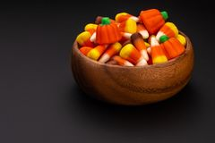 Multicolor candy corn in a bowl royalty free stock photography