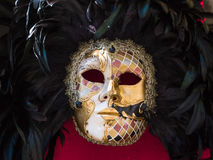 Multicolor Carnival Venetian Mask on Red Background Royalty Free Stock Images