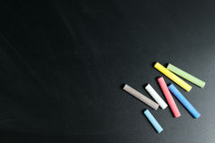 Multicolor chalk on chalkboard Royalty Free Stock Photos
