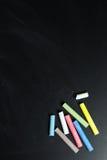 Multicolor chalk on chalkboard Stock Image