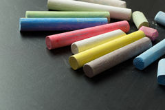 Multicolor chalk on chalkboard Stock Photos