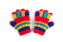 Multicolor children`s gloves. Isolated on white background royalty free stock photos