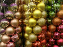 Christmas decorative balls. Multicolor Christmas and New Year decorative balls in containers Royalty Free Stock Photo