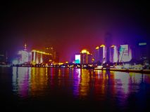 Multicolor city, lights, water, evanescence and bright urban landscape. Reflections and skyscrapers, big city life and artistic shining view, modernity stock image