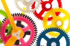 Multicolor clockwork. Full-frame background multicolor clockwork cogs isolated on white with selective focus Stock Images