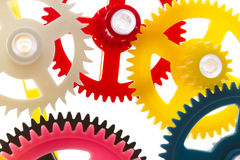 Multicolor clockwork. Full-frame background multicolor clockwork cogs isolated on white with selective focus Stock Photography