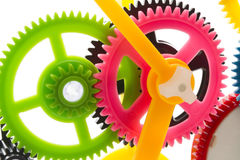 Multicolor clockwork. Full-frame background multicolor clockwork cogs isolated on white with selective focus Stock Photo