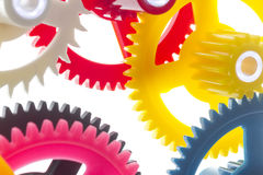 Multicolor clockwork. Full-frame background multicolor clockwork cogs isolated on white with selective focus Royalty Free Stock Photos