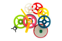 Multicolor clockwork. Group multicolor clockwork cogs mechanism isolated on white Stock Photos