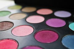 Multicolor and comfortable palette of eyeshadow. Multicolor and comfortable palette of eye shadow and make-up, eyes eyes, beautiful evening make-up, for Royalty Free Stock Image