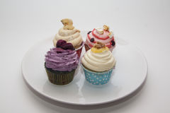 Multicolor cupcakes Stock Images