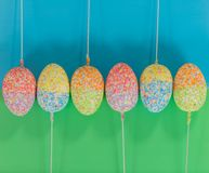 Decorated easter eggs on sticks in line Royalty Free Stock Photos