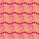 Multicolor dots forming a heart shape and lines of small red hearts, a seamless romantic pattern on a pink background royalty free illustration