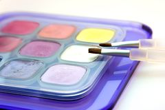 Multicolor eye shadows. Set of multicolor eye shadows with brushes Royalty Free Stock Images