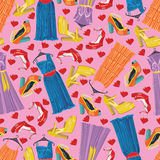 Multicolor fashionable dresses,open shoes,hearts.S. Seamless pattern of three females cocktail dresses , high heel open shoeses and hearts.Black background.Use Stock Photo