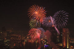 Multicolor fireworks with bangkok cityscape. Multicolor fireworks night scene, bangkok cityscape river view Stock Images