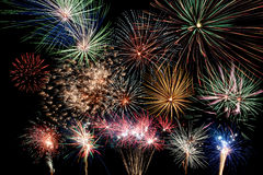 Multicolor fireworks display. On black background Royalty Free Stock Image