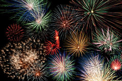 Multicolor fireworks display. On black background royalty free stock photos