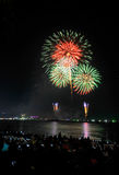 Multicolor fireworks night scene. Closeup with pattaya cityscape sea beach view, Thailand Stock Photography