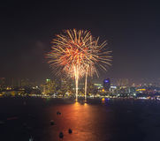Multicolor fireworks night scene, pattaya cityscape sea beach vi Stock Image
