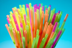 Multicolor flexible straws in the glass closeup Stock Images