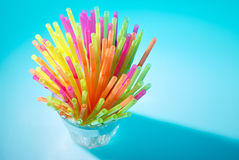 Multicolor flexible straws in the glass closeup Royalty Free Stock Images