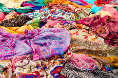 Multicolor foulards. A lot of foulards exposed in a store Stock Image