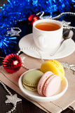 Multicolor French macaroons sweet treats Christmas present. Vertical Royalty Free Stock Photo