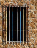 Multicolor grating. Multicolor old grating in a window without doors stock photo