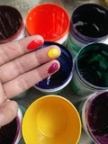 Multicolor in hand. Hand and color cans Stock Images