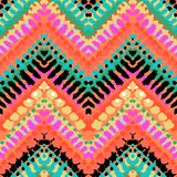 Multicolor hand drawn pattern zigzag. Striped hand painted vector seamless pattern with ethnic and tribal motifs, zigzag lines, brushstrokes and splatters of royalty free illustration