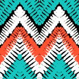 Multicolor hand drawn pattern zigzag. Striped hand painted vector seamless pattern with ethnic and tribal motifs, zigzag lines, brushstrokes and splatters of stock illustration