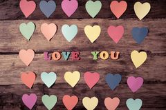 Multicolor hearts on wood background and text Love you for Valentine day and love celebration royalty free stock photos