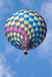 Multicolor hot air balloon in flight. Multicolor hot air balloons in flight on a beautiful day royalty free stock photos