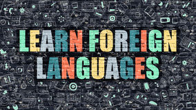 Multicolor Learn Foreign Languages on Dark Brickwall. Learn Foreign Languages - Multicolor Concept on Dark Brick Wall Background with Doodle Icons Around Stock Image