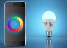 Multicolor LED bulb with remote control by phone Royalty Free Stock Photo