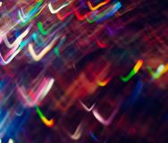 Multicolor Light waves dancing around the atmosphere. Multicolor Light waves play in space. motion blur. Fun Camera trick. Party Scene, Rush of energies royalty free stock images