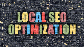 Multicolor Local SEO Optimization on Dark Brickwall. Royalty Free Stock Images