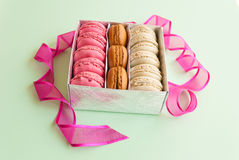 Multicolor macaroons in the silver gift box Royalty Free Stock Photos
