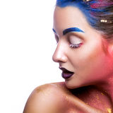 Multicolor make up on gorgeous woman on white background Stock Photography
